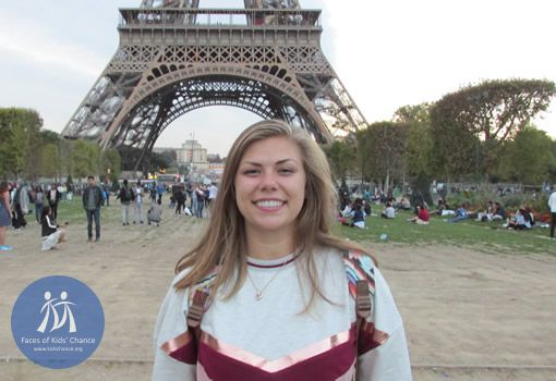 Photo of Emily K. in front of the Eiffel Tower.